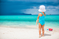 Adorable little girl playing with beach toys on white tropial beach - PhotoDune Item for Sale