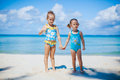 Adorable little girls have a lot of fun on the beach - PhotoDune Item for Sale