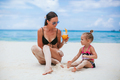 Adorable little girls and young mother on tropical white beach - PhotoDune Item for Sale