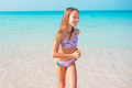 Adorable little girl at beach on her summer vacation - PhotoDune Item for Sale