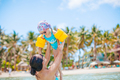 Young beautiful mother having fun with her daughter on tropical beach vacation - PhotoDune Item for Sale