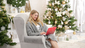Portrait of smiling woman holding laptop on her laps and working. Sitting on comfortable armchair - PhotoDune Item for Sale