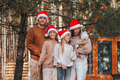 Beautiful family with kids walking at Christmas day - PhotoDune Item for Sale