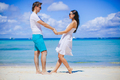 Young couple on white beach during summer vacation - PhotoDune Item for Sale