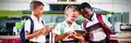 School kids using digital tablet in school cafeteria - PhotoDune Item for Sale