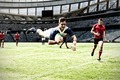 Digital composite image of rugby player jumping with the ball in sports stadium - PhotoDune Item for Sale