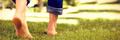 Woman walking on grass - PhotoDune Item for Sale