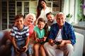 Family enjoying video game in living room - PhotoDune Item for Sale