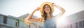 Composite image of portrait of a woman touching her straw hat - PhotoDune Item for Sale