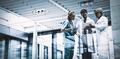 Medical team discussing over digital tablet in corridor - PhotoDune Item for Sale