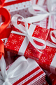 Christmas concept. Close up on festive paper wrapped gifts with ribbon - PhotoDune Item for Sale