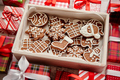 Delicious fresh Christmas decorated gingerbread cookies placed in wooden crate - PhotoDune Item for Sale
