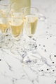 Champagne glasses and bottle placed on white marble background - PhotoDune Item for Sale