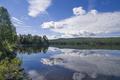 Clouds reflecting in lake Funasdalssjon - PhotoDune Item for Sale