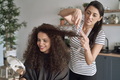 Happy women while trimming their hair at home - PhotoDune Item for Sale