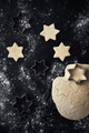 Vertical top view of raw Christmas cookies on black background - PhotoDune Item for Sale