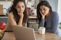 Two dissatisfied women during a video call at home - PhotoDune Item for Sale