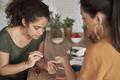 Women applying nail polish at home - PhotoDune Item for Sale