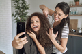 Happy women taking funny selfie during trimming their hair - PhotoDune Item for Sale