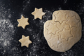Top view of raw star shaped cookies over black background - PhotoDune Item for Sale