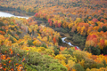 High angle view of trees in brilliant fall color near lake and river - PhotoDune Item for Sale