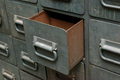 Old gray metal cabinet with drawers, one drawer opened - PhotoDune Item for Sale