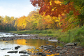 River with rocks near trees in fall color on the Upper Peninsula of northern Michigan - PhotoDune Item for Sale