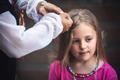 Chinese woman braiding Caucasiuan girl hair - PhotoDune Item for Sale