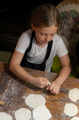 Little girl learning how to make dumplings - PhotoDune Item for Sale