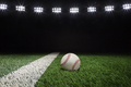 Baseball on a grass field with stripe and black background under lights - PhotoDune Item for Sale