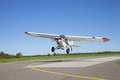 Small airplane takes off from a municipal airport on a sunny afternoon - PhotoDune Item for Sale