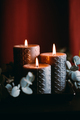 New Year festive decorations with wooden box and black burning candles - PhotoDune Item for Sale