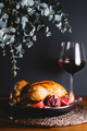 Whole roast chicken with pomegranate, apple and red wine on a festive table - PhotoDune Item for Sale