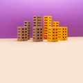 Miniature city with yellow brown houses on purple beige background. - PhotoDune Item for Sale