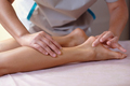 Caucasian woman receiving a leg massage on spa therapy. Healthcare concept. - PhotoDune Item for Sale
