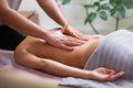 Caucasian woman getting a back massage in the spa salon - PhotoDune Item for Sale