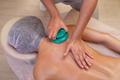 Massage therapist massaging young woman. Vacuum massage - PhotoDune Item for Sale