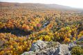 Hills and valley in Michigan with trees in brilliant fall color above a small river - PhotoDune Item for Sale