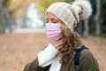 Illness young woman with terrible throat pain walking to the street. - PhotoDune Item for Sale