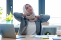 Tired young muslim business woman wearing hijab with neck pain at the office. - PhotoDune Item for Sale
