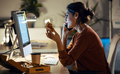 Beautiful young business woman working with computer while eating pizza sitting in the office. - PhotoDune Item for Sale