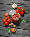 Tomato sauce in a glass jar with Bay leaf and cherry. - PhotoDune Item for Sale