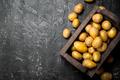 Yellow potatoes in the box. - PhotoDune Item for Sale
