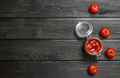Tomato sauce in a glass jar and fresh tomatoes. - PhotoDune Item for Sale