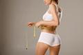 Unrecognazible slim tanned woman measure her waist - PhotoDune Item for Sale