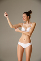 Woman pinching skin on her hand checking subcutaneous body fat - PhotoDune Item for Sale