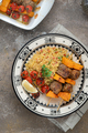 Moroccan couscous with lamb kebab on skewers on traditional plate - PhotoDune Item for Sale