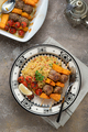 Kebab on skewers with pumpkin and couscous on a plate - PhotoDune Item for Sale
