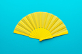 Top View Of Opened Yellow Hand Fan On Turquoise Blue Background With Copy Space - PhotoDune Item for Sale