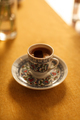 turkish coffee in decorative eastern cup on orange tablecloth - PhotoDune Item for Sale